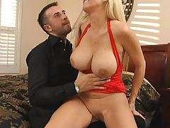 Hot big titted milf pulls up her tight little red dress