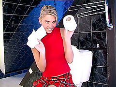 Teenie blonde has some toy fun in the toilet