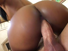 Nice black ass all in lotion sitting on cock