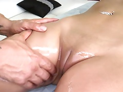 Nice oil massage with Jynx Maze laying on the table naked