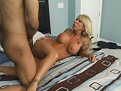 Busty babe spreads her shaved pussy for deep fuck