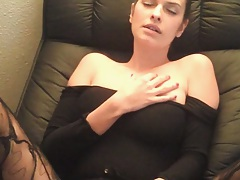 Sexy gf laying on her back inserting a dildo