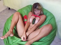 Cute teen in red shuvs cucumbers into her holes
