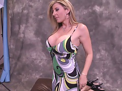 Big tits babe changes and a guy peaks at her boobies