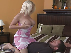 Busty milf in a sexy dress shows tits and sucks penis