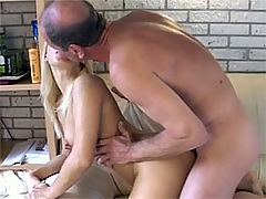 Blonde girl plays with the cum of an old guy