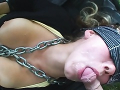 Slut in chains with covered eys and facial cumshot