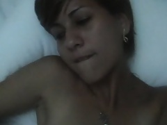 Chick filming herself as she plays with her own body