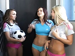 Three cute babes are all sweaty after soccer match