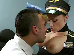 Big tits flight attendant exposes tits and sucks