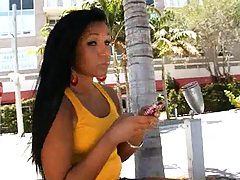 Cute latina outdoors in a yellow top