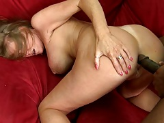 Big black cock doggy style penetrating a big tits milf