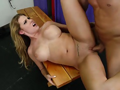 Fucking a whore with big tits on the locker room bench
