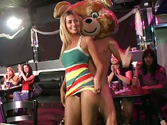 Dancing bear rolling up her skirt and fingering infront of everyone
