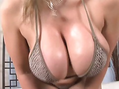 Big tits Sara Jay oils up her boobies