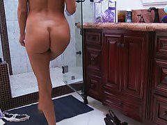 BIg tits dirty milf shaving her legs in the shower