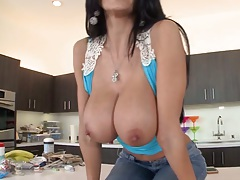 Ava Addams flipping her tits out on kitchen counter then takes off her pants solo