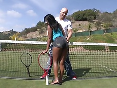 Monique Symone playing some tennis outdoors and showing ass