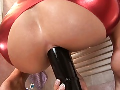 Hairy skank shoves a large sex toy right up the shit hole