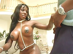 Oiled up big tit black babe Kelly Starr sucking large cock