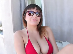 Mali Luna wearing a sexy red bikini over big tits