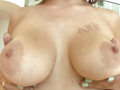 Big tits babe Mc Carthy shows her natural boobs