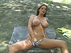 Natural big tits Sheila Grant solo reaching down her panties outdoors in public park
