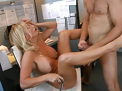 Big tits boss spreads her legs on office chair