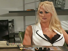 Stormy Daniels a blonde babe in the office spreading legs on table