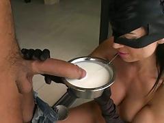 Slut dips cock into milk and sucks it wet