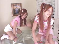 Redhead lesbian girls fucking around in miniskirts on glass table
