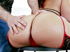 Fingering round ass slut on a chair