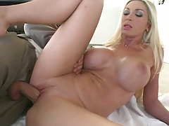 Busty boss fucked by a dressed guy in a suit