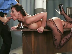 Prison guard loads big tits milf Phoenix Marie on his work desk