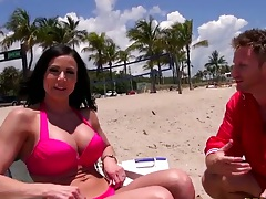 Public milf in a bikini on a beach outdoors getting tan