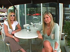 Two asses Summer and Carmen Kinsley walking on the public street