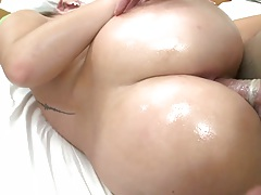 Nikki Stone and her nice ass fucked with oil during massage