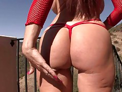 Outdoors with Tiffany Mynx showing her ass and big tits