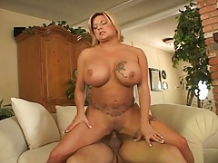 Busty mom with tattoos on her tits gets fucked