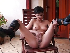 Coco De Mal spreading her legs up high on a chair